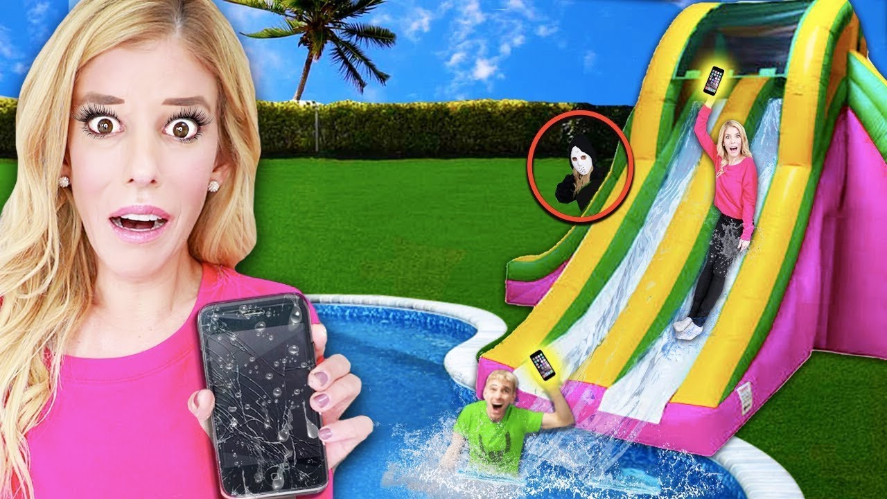 LAST TO DROP Wins iPhone on Inflatable Water Slide in Backyard! (Game Master Spy in Real Life)